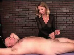 Milf Masseuse Teases Client's Cock With Vibrator