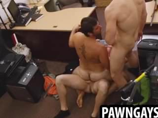 Horny Hunk Taking On Two Hard Cocks At The Pawn Shop